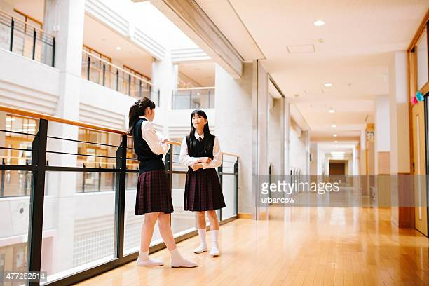Japanese high school. Students chat, first floor corridor, overlooking atrium