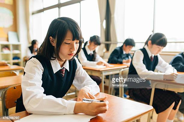 japanese high school students doing exams - japanese culture stock pictures, royalty-free photos & images