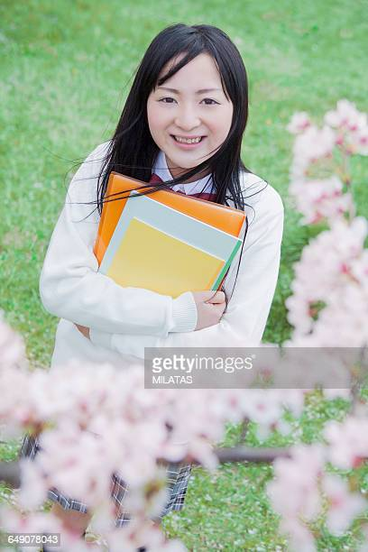 japanese high school students stand under the tree of cherry tree with a note - new cherry stock pictures, royalty-free photos & images