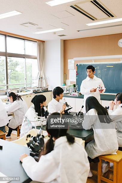Japanese high school. Students study, science laboratory, microscopes on benches