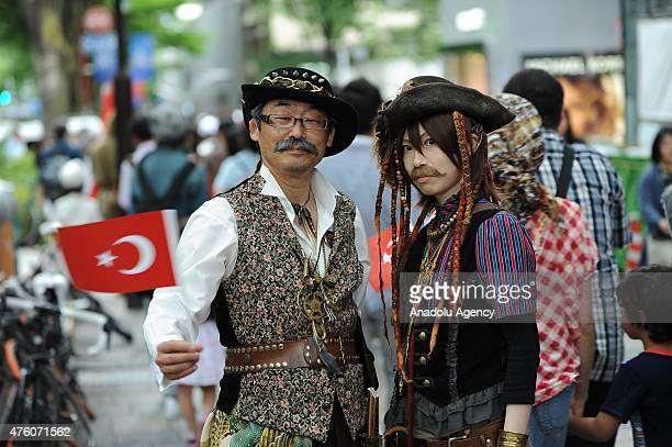 Japanese holds a Turkish flag as traditional Mehteran parade during the 125th Commemoration of Ottoman Ertugrul imperial frigate in the Tokyo...