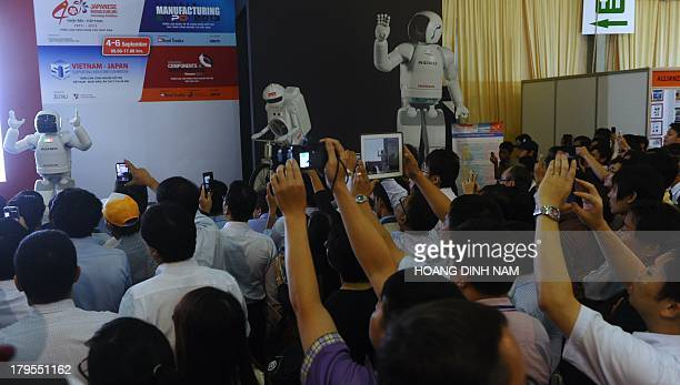 Japanese Honda's Asimo robot performs a show during an exhibition featuring VietnamJapan supporting industries and Japanese technology in Hanoi on...