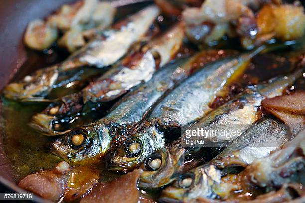japanese horse mackerel being cooked - trachurus japonicus stock pictures, royalty-free photos & images