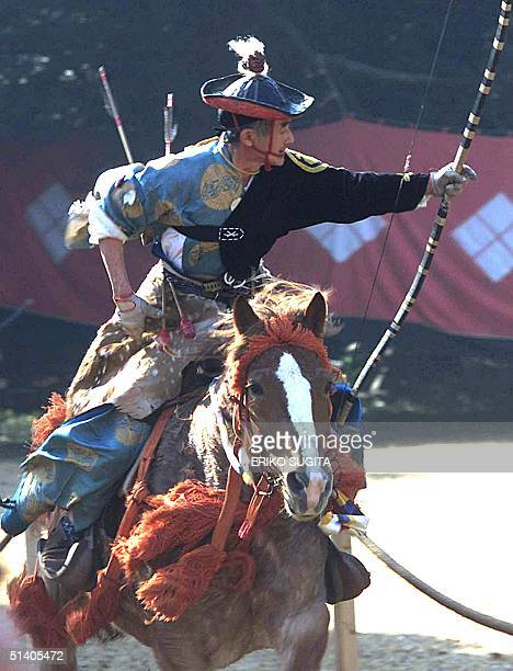 Japanese horseman in samurai warrior costume performs a traditional Japanese yabusame mounted archery demonstration for visiting US President George...
