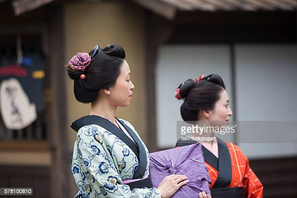 japanese housewifes with kimono in toei studio oldtown kyoto japan - lypsekyo16 stock pictures, royalty-free photos & images