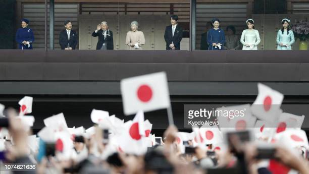 Japanese imperial family members arrive onto a balcony at the Imperial Palace in Tokyo from where they greeted a crowd gathered to celebrate Emperor...