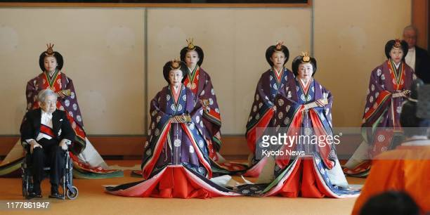 Japanese imperial family members clad in traditional attire are pictured at the Matsu no Ma state room of the Imperial Palace in Tokyo ahead of...