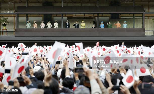 Japanese imperial family members led by Emperor Naruhito wave to thousands of wellwishers gathered at the Imperial Palace in Tokyo on May 4 2019 It...