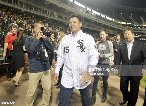 Japanese infielder Tadahito Iguchi leaves the field after throwing out the ceremonial first pitch for his former major league team the Chicago White...