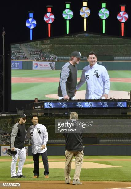 Japanese infielder Tadahito Iguchi poses for photos before throwing out the ceremonial first pitch for his former major league team the Chicago White...