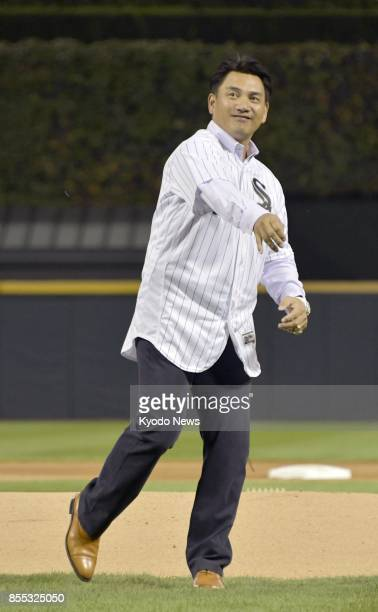 Japanese infielder Tadahito Iguchi throws out the ceremonial first pitch for his former major league team the Chicago White Sox in a game against the...