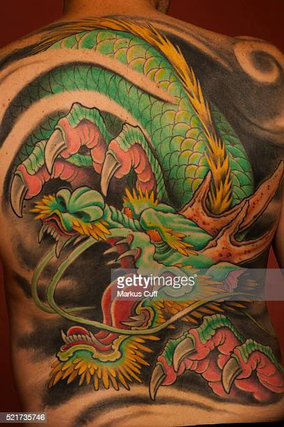 Japanese inluenced cartoon dragon back piece by Aaron Bell,Seattle, Washington.