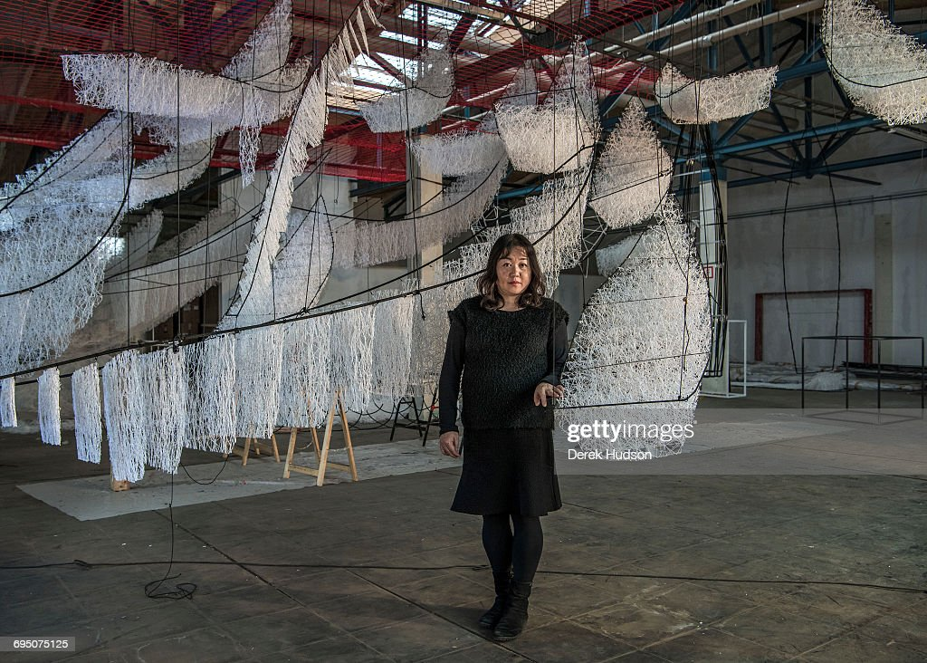 Japanese installation artist Chiharu Shiota is based in Berlin since 1996. She studied at the Seika University in Kyota, Japan and in various German schools. Renowned for her vast web of room spanning objects in which she combines everyday objects with a web of threads she most recently installed a vast work at the famous Paris department store Le Bon Marché.