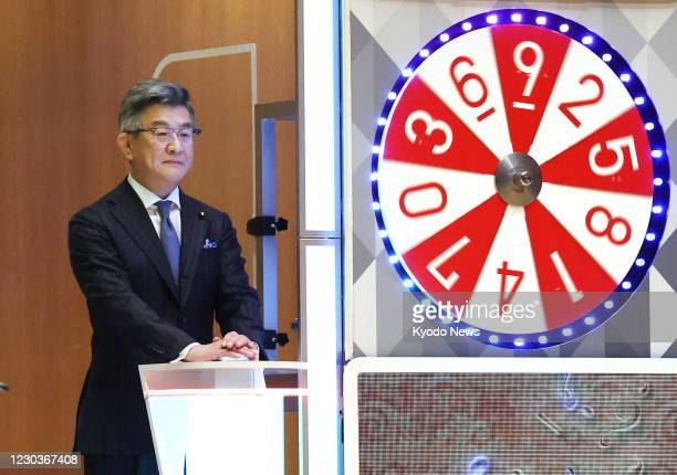 Japanese Internal Affairs and Communications Minister Ryota Takeda attends the year-end Jumbo lottery draw in Tokyo on Dec. 31 with up to 1 billion...