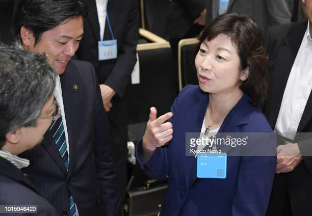 Japanese Internal Affairs and Communications Minister Seiko Noda speaks using a multilingual voice translation device during a demonstration event in...