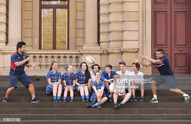 Japanese Internationals and Rebels players Shota Horie and new signing Male Sau showcase their passing skills to students on the steps of Treasury...