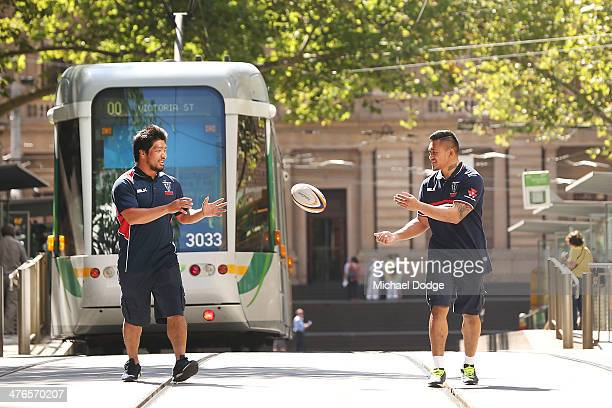 Japanese Internationals and Rebels players Shota Horie and new signing Male Sau pass the ball to each other on the Collins St tram tracks during a...