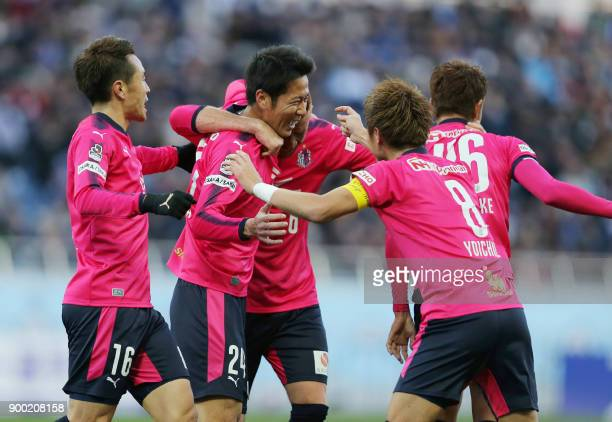 Japanese JLeague club Cerezo Osaka midfielder Kazuya Yamamura celebrates his goal with teammates during the Emperor's Cup football final between...