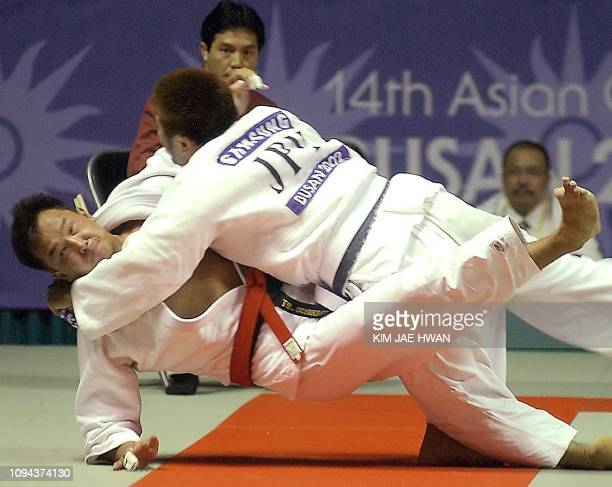 Japanese judo player Yuta Yazaki in action against Mongolian Ochirbat Tsend-ayush during the final match of Men's Judo under 90Kg at 14th Asian Games...