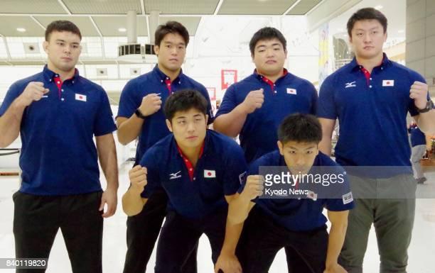 Japanese judoka Aaron Wolf Ryunosuke Haga Takeshi Ojitani Hisayoshi Harasawa Kenta Nagasawa and Riki Nakaya pose for a photo at Narita airport near...