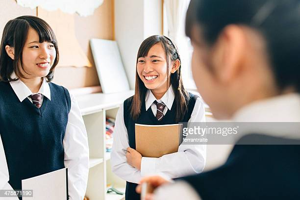 japanese junior high school girl students in between classes - female high school student stock pictures, royalty-free photos & images