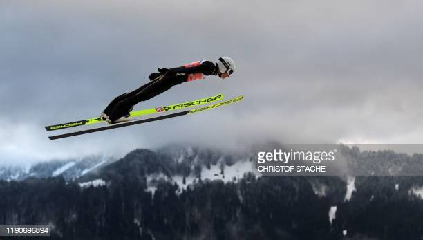 TOPSHOT Japanese Junshiro Kobayashi soars in the air during his first training jump at the FourHills Ski Jumping tournament on December 28 2019 in...