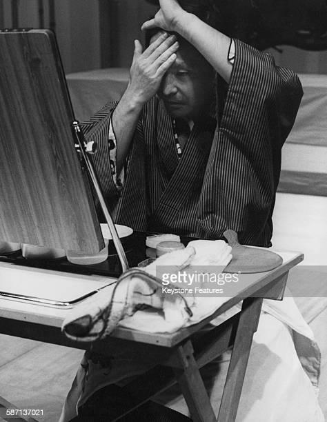 Japanese Kabuki actor Ichikawa Ennosuke III applies his makeup for a dress rehearsal at Sadler's Wells in London UK October 1981