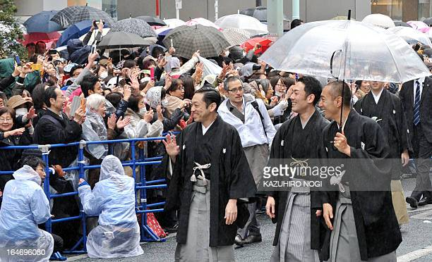 Japanese kabuki actors Ichikawa Chusha Nakamura Kankuro and Ichikawa Ebizo walk on a street for the parade at Tokyo's Ginza district on Marh 27 2013...