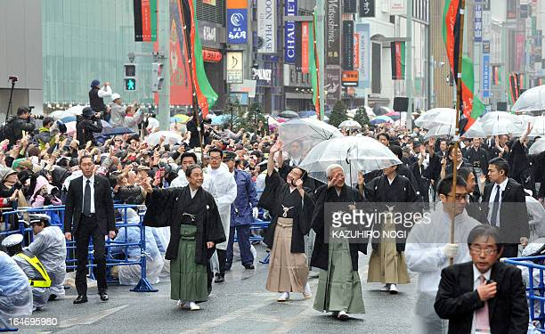 Japanese kabuki actors walk on a street for the parade at Tokyo's Ginza district on Marh 27 2013 as the newly rebuilt Kabukiza theatre will open on...