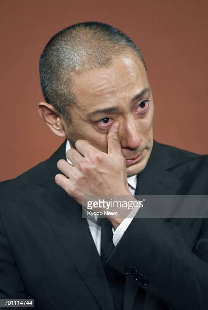 Japanese kabuki star Ichikawa Ebizo wipes away tears during a press conference in Tokyo on June 23 after his wife Mao Kobayashi a 34yearold Japanese...