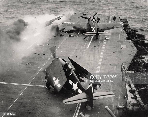 Japanese kamikaze aircraft has just struck the deck of the US aircraft-carrier 'Saratoga' CV-3, flying to Iwo Jima, and has caused a fire. Pacific...