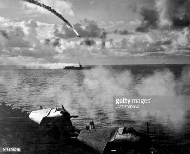 "Japanese kamikaze plane shot down as it attempted to attack USS Kitkun Bay."" Near Mariana Islands, June 1944."