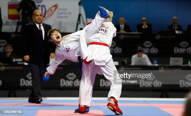 Japanese karateka Ayumi Uekusa seen fighting with Greek karateka Eleni Chatziliadou to compete for the Gold Medal during the Kumite female 68kg final...