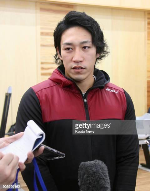 Japanese kayaker Seiji Komatsu speaks to reporters in Komatsu Ishikawa Prefecture on Jan 11 after he received encouragement from Japan Canoe...