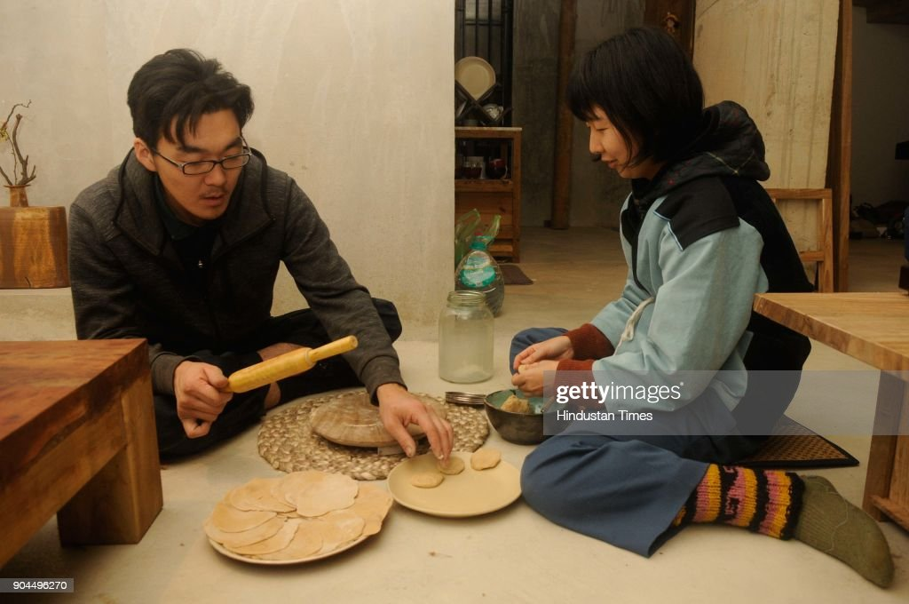 Japanese Kazuhiro Aoshima (Carpenter) and Sayuri Hashimoto (Mending Designer) are busy making Indian bread at Japanese house-cum-studio to commemorate the centenary of Poet Rabindranath Tagore's first visit to Japan, at Purbapally in Santiniketan, Birbhum dist, on January 8, 2018 in Kolkata, India. A six-member team from Japan is helping poet-curator Nilanjan Bandyopadhyay to build a traditional Japanese house-cum-studio as part of a cross-cultural creative experiment. Poet-curator Nilanjan Bandyopadhyay has embarked on the cross-cultural creative experiment in 2016, the centenary year of the Nobel laureates' first Japan visit. Poet Rabindranath Tagore was so impressed with Japanese arts, architecture and gardens that he had once written, had it been possible he would take an entire Japanese house, decked up with its furniture, to Bengal.