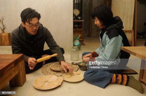 Japanese Kazuhiro Aoshima and Sayuri Hashimoto are busy making Indian bread at Japanese housecumstudio to commemorate the centenary of Poet...