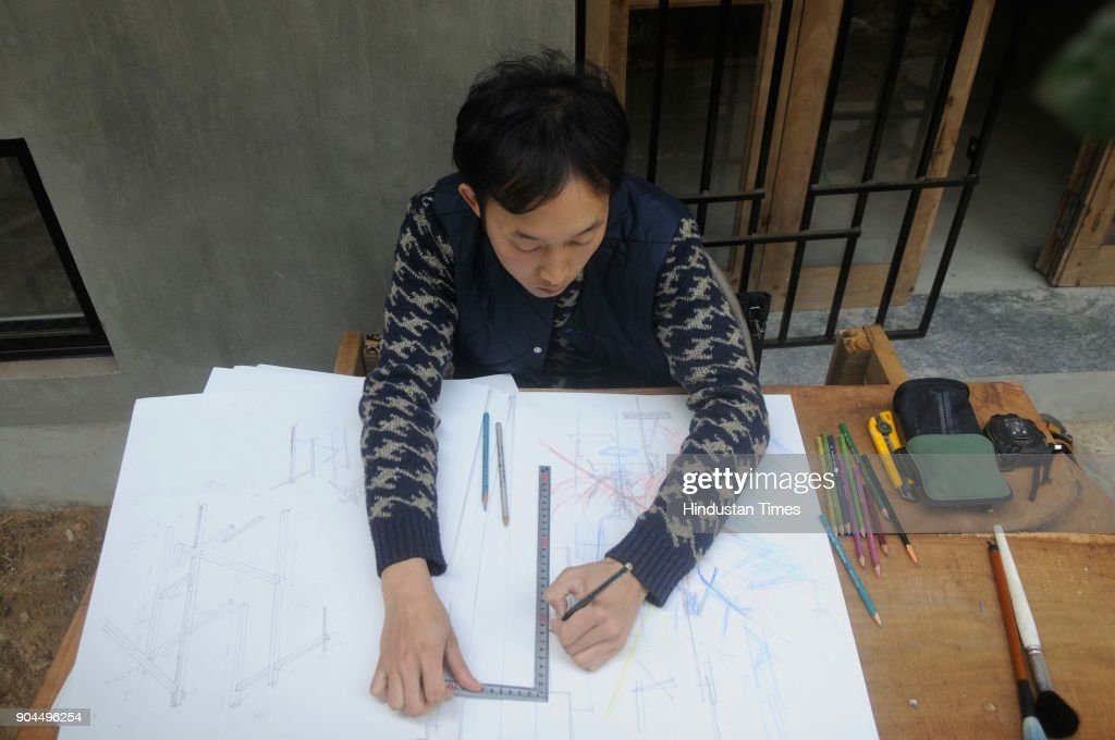 Japanese Kengo Sato (Architect) at work at Japanese house-cum-studio to commemorate the centenary of Poet Rabindranath Tagore's first visit to Japan, at Purbapally in Santiniketan, Birbhum dist, on January 8, 2018 in Kolkata, India. A six-member team from Japan is helping poet-curator Nilanjan Bandyopadhyay to build a traditional Japanese house-cum-studio as part of a cross-cultural creative experiment. Poet-curator Nilanjan Bandyopadhyay has embarked on the cross-cultural creative experiment in 2016, the centenary year of the Nobel laureates' first Japan visit. Poet Rabindranath Tagore was so impressed with Japanese arts, architecture and gardens that he had once written, had it been possible he would take an entire Japanese house, decked up with its furniture, to Bengal.
