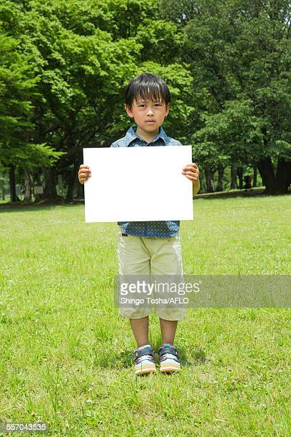 Japanese kid with whiteboard in a park