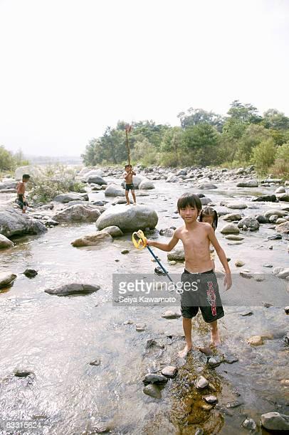 Japanese kids on river