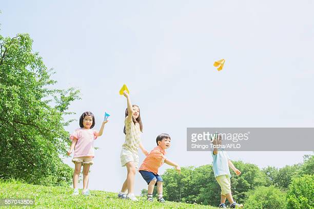 Japanese kids playing in a park