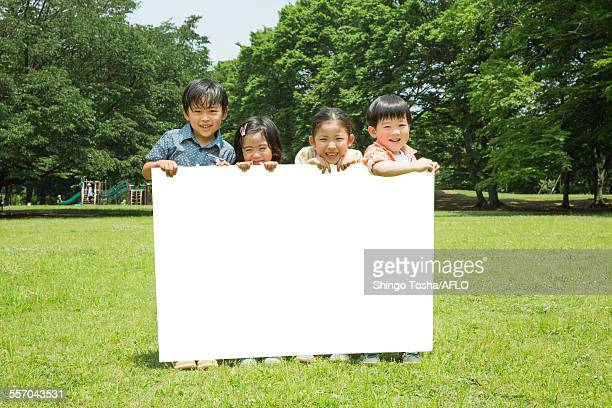 Japanese kids with whiteboard in a park