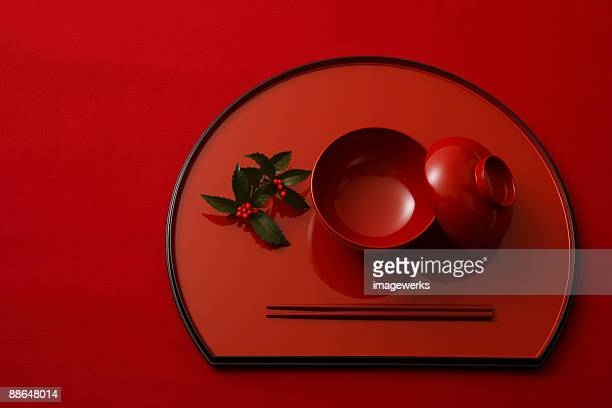 Japanese lacquer ware against red background, close-up