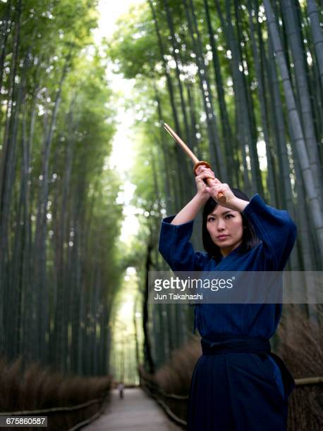 A Japanese lady is practicing kendo