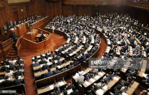 Japanese lawmakers attend a plenary session at the House of Representatives on May 29 2018 The lower house approved bills to lower the age of...