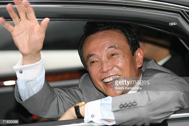Japanese Liberal Democratic Party candidate Foreign Minister Taro Aso waves to the crowd during joint public speeches in front of JR Akihabara...