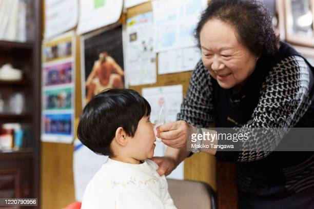 japanese little girl and her grandmother - nasal mucus stock pictures, royalty-free photos & images