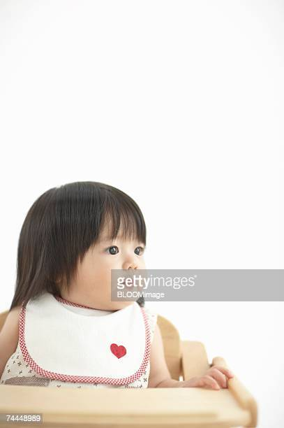 Japanese little girl sitting on chair