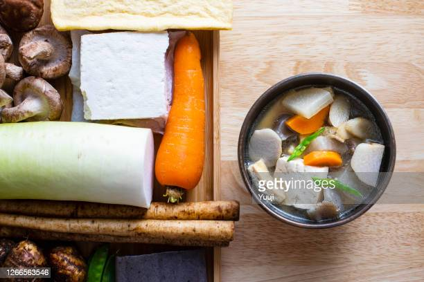 japanese local cuisine. soup dish in japanese (kentinjiru) recipe. - aburaage stock pictures, royalty-free photos & images