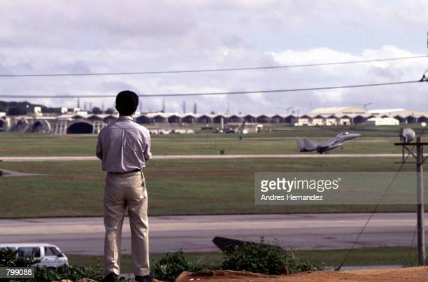 Japanese local looks at Camp Foster the US military base in Okinawa Japan April 17 1997 The presence of US military is causing gradual...