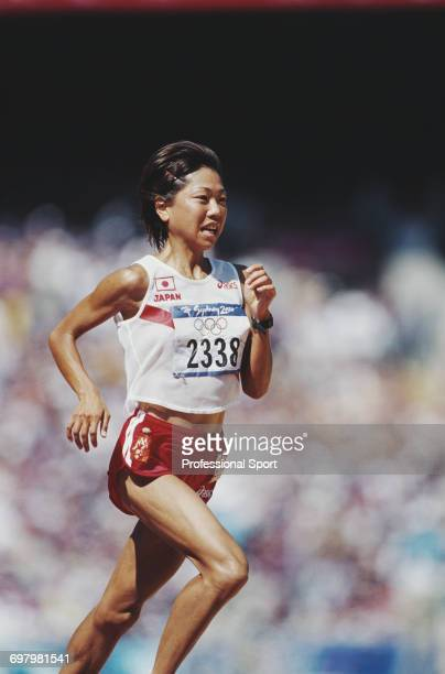 Japanese long distance runner Naoko Takahashi pictured during competition to finish in first place to win the gold medal for Japan in the Women's...